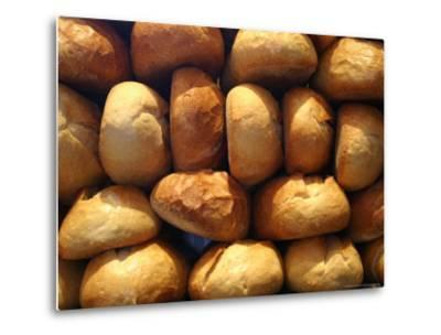Wall of Fresh-Baked Loaves of Bread Awaits Buyers at the Bakery-Stephen St^ John-Metal Print