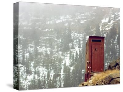 Outhouse Perches on a Hillside-Rex Stucky-Stretched Canvas Print