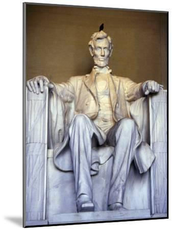 Bird Perches on Abraham Lincoln's Statue Inside the Lincoln Memorial-Rex Stucky-Mounted Photographic Print