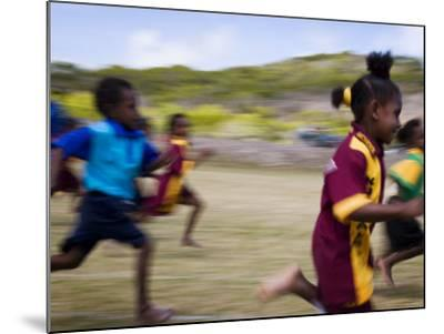 Local School Girls Competing in Race During an Inter-Island School Sports Carnival-Tim Barker-Mounted Photographic Print
