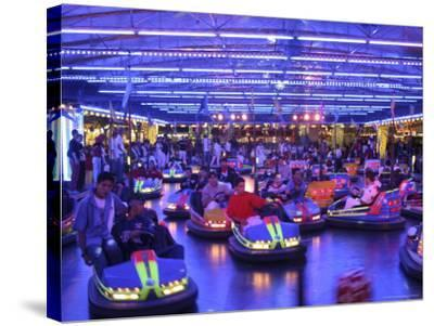 Teenagers Ride Bumper Cars under Neon Blue Lights-Dominic Bonuccelli-Stretched Canvas Print
