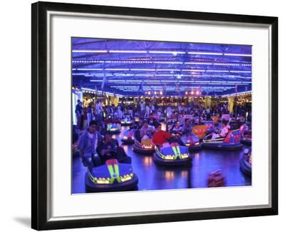 Teenagers Ride Bumper Cars under Neon Blue Lights-Dominic Bonuccelli-Framed Photographic Print