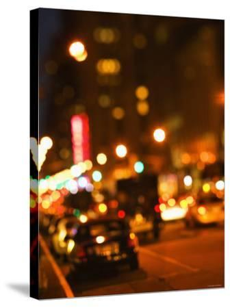 Blurred View of Cars and Illuminating Lights and Signs on Busy City Street at Night--Stretched Canvas Print