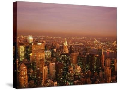Aerial View of New York City at Night with Illuminating Lights from Buildings and Skyscrapers--Stretched Canvas Print