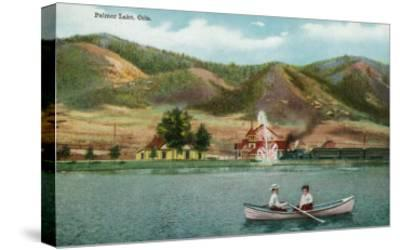 Palmer Lake, Colorado, View of a Couple in a Rowboat on the Lake-Lantern Press-Stretched Canvas Print