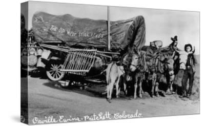 Pritchett, Colorado, View of Orville Ewing with his The Old West Still Lives Wagon-Lantern Press-Stretched Canvas Print