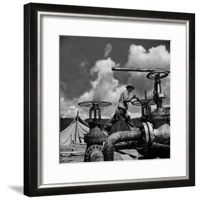 Worker Opening up a Pipeline to Let the Oil Flow-Thomas D^ Mcavoy-Framed Photographic Print