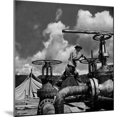 Worker Opening up a Pipeline to Let the Oil Flow-Thomas D^ Mcavoy-Mounted Photographic Print