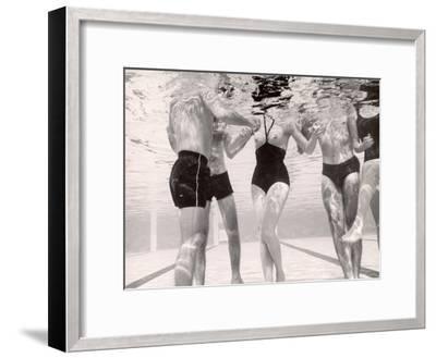 Underwater Shot of Actress Daphne Dayle in Topless, One Piece Swim Suit by Designer Ruben Torres-Paul Schutzer-Framed Photographic Print