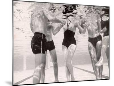 Underwater Shot of Actress Daphne Dayle in Topless, One Piece Swim Suit by Designer Ruben Torres-Paul Schutzer-Mounted Photographic Print