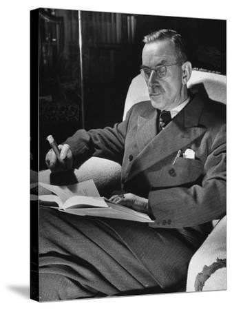 German-Born Writer Thomas Mann Reading a Book at Home-Carl Mydans-Stretched Canvas Print