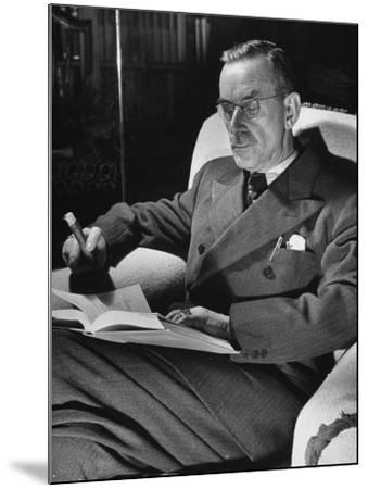 German-Born Writer Thomas Mann Reading a Book at Home-Carl Mydans-Mounted Premium Photographic Print