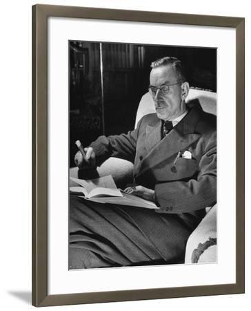 German-Born Writer Thomas Mann Reading a Book at Home-Carl Mydans-Framed Premium Photographic Print