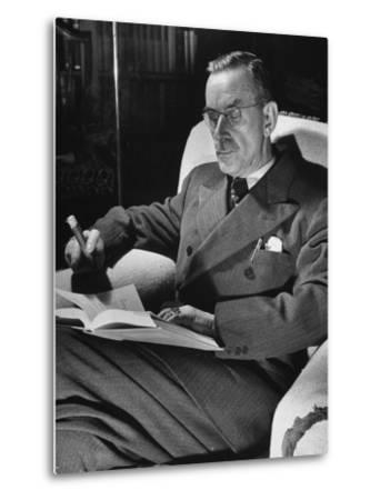 German-Born Writer Thomas Mann Reading a Book at Home-Carl Mydans-Metal Print