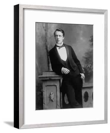 Elgant Young Man Posing for Studio Portrait Attired in Black Tie and Tails--Framed Photographic Print