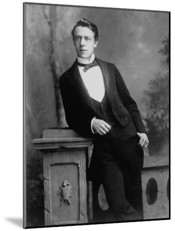 Elgant Young Man Posing for Studio Portrait Attired in Black Tie and Tails--Mounted Photographic Print