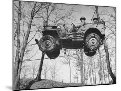 Group of Us Soldiers Pulling a Jeep over a Ravine Using Ropes while on Maneuvers-William C^ Shrout-Mounted Photographic Print