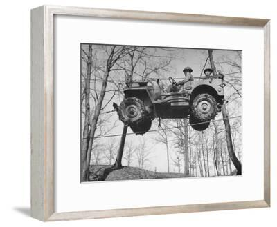 Group of Us Soldiers Pulling a Jeep over a Ravine Using Ropes while on Maneuvers-William C^ Shrout-Framed Photographic Print