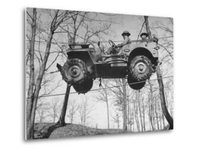 Group of Us Soldiers Pulling a Jeep over a Ravine Using Ropes while on Maneuvers-William C^ Shrout-Metal Print