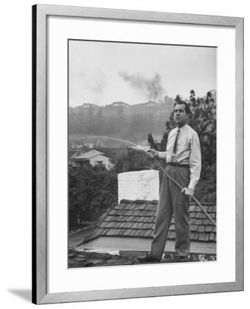 Senator Richard M. Nixon on Roof of Home in Los Angeles, Putting Out Fires Caused by Brush Blaze-Allan Grant-Framed Photographic Print