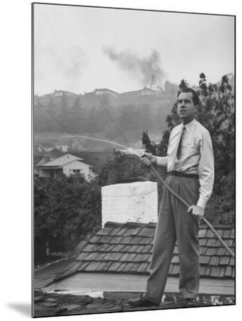 Senator Richard M. Nixon on Roof of Home in Los Angeles, Putting Out Fires Caused by Brush Blaze-Allan Grant-Mounted Photographic Print