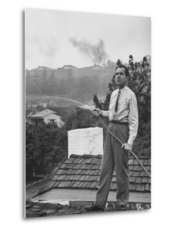 Senator Richard M. Nixon on Roof of Home in Los Angeles, Putting Out Fires Caused by Brush Blaze-Allan Grant-Metal Print