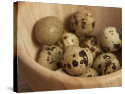Exotic Bird Eggs in Wooden Bowl on Table--Stretched Canvas Print