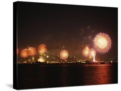 Fireworks Celebration with Manhattan Skyline and Statue of Liberty, Manhattan, New York--Stretched Canvas Print