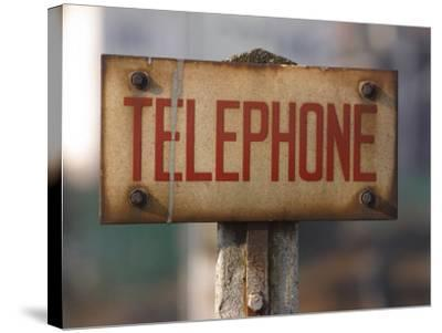 Close-Up of Singed Telephone Sign Outdoors--Stretched Canvas Print