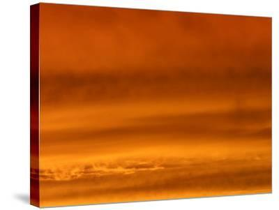 Fiery Red and Orange Sunset Illuminating the Night Sky--Stretched Canvas Print