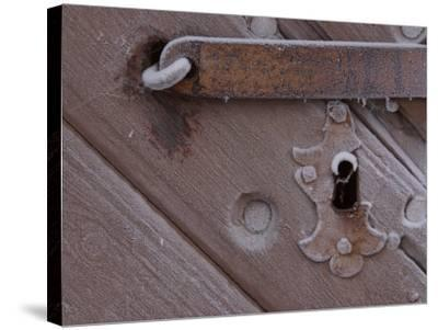 Metal Keyhole and Latch on Rustic Snow-Covered Wooden Door--Stretched Canvas Print
