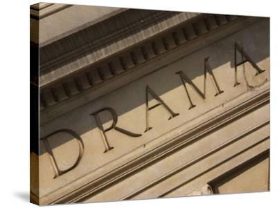 Drama Engraved on Building--Stretched Canvas Print