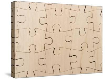 Completed Puzzle Pieces Textured Background--Stretched Canvas Print