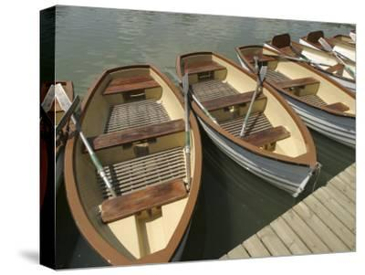 Rowboats with Oars Alongside a Dock--Stretched Canvas Print