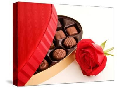 Studio Shot of Box of Romantic Chocolates and Red Rose--Stretched Canvas Print