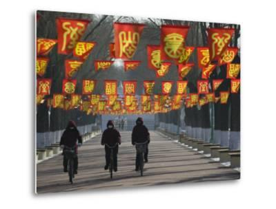 Bicycle Riders at Entranceway to Festival, Ice and Snow Festival, Harbin, Heilongjiang, China-Walter Bibikow-Metal Print