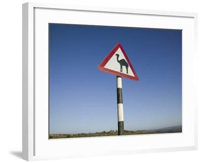 Oman, Dhofar Region, Salalah, Camel Crossing Sign in the Dhofar Mountains-Walter Bibikow-Framed Photographic Print