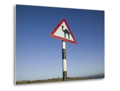 Oman, Dhofar Region, Salalah, Camel Crossing Sign in the Dhofar Mountains-Walter Bibikow-Metal Print