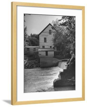Man Fishing Beside a Waterfall and a 100 Year Old Mill-Bob Landry-Framed Photographic Print