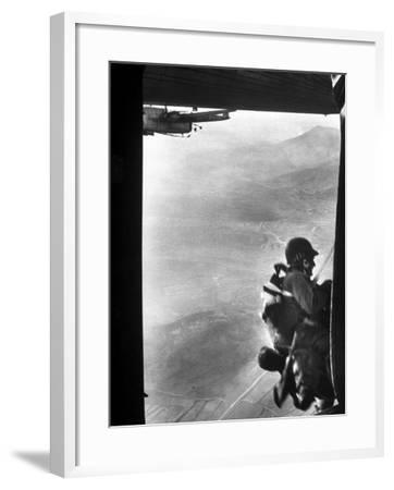 Paratrooper Making Way to Jump Off a Military Plane into Hostile Territories-John Dominis-Framed Photographic Print