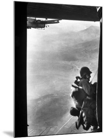 Paratrooper Making Way to Jump Off a Military Plane into Hostile Territories-John Dominis-Mounted Photographic Print