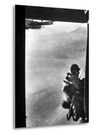 Paratrooper Making Way to Jump Off a Military Plane into Hostile Territories-John Dominis-Metal Print
