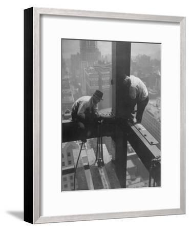 Workmen Attaching Steel Beams High Above Street During Construction of Manhattan Company Building-Arthur Gerlach-Framed Photographic Print