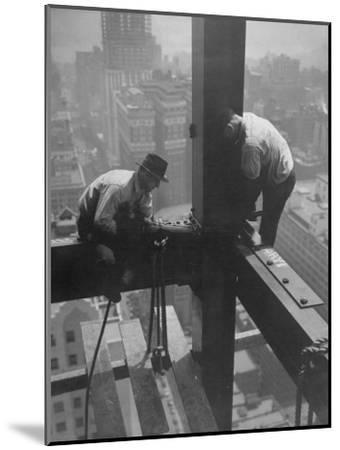 Workmen Attaching Steel Beams High Above Street During Construction of Manhattan Company Building-Arthur Gerlach-Mounted Photographic Print
