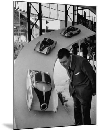Man Admiring Fiat Automobile Exhibit at the Milan Fair-Ralph Crane-Mounted Photographic Print