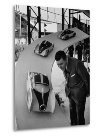 Man Admiring Fiat Automobile Exhibit at the Milan Fair-Ralph Crane-Metal Print