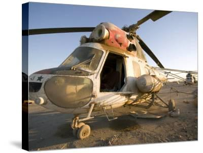 Iraqi Helicopter Sits on the Flight Deck Abandoned at Camp Warhorse-Stocktrek Images-Stretched Canvas Print