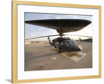 UH-60 Blackhawk Medivac Helicopter Sits on the Flight Deck at Camp Warhorse-Stocktrek Images-Framed Photographic Print