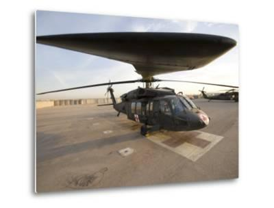 UH-60 Blackhawk Medivac Helicopter Sits on the Flight Deck at Camp Warhorse-Stocktrek Images-Metal Print