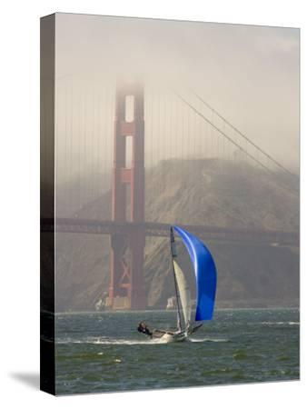International 14 Skiff Sails under the Golden Gate Bridge, San Francisco Bay, California-Skip Brown-Stretched Canvas Print